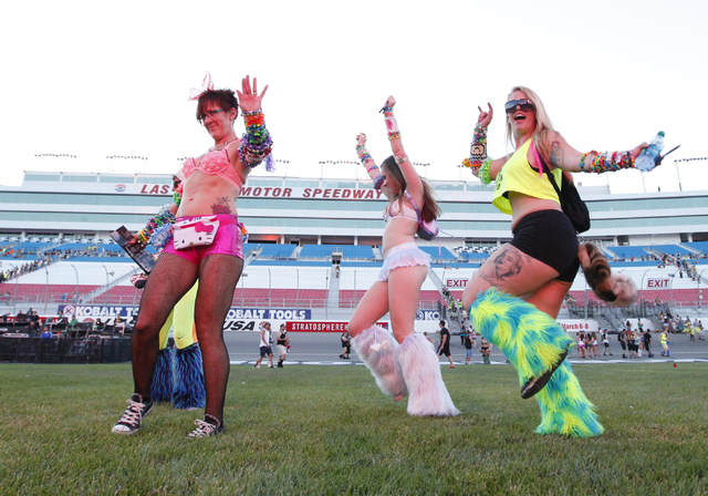 Melissa DeAngeles, left, mother of Jamie Bindon, center, with Jori Barr, dance to Wax Motif at the Cosmic Meadow stage at the Electric Daisy Carnival at Las Vegas Motor Speedway on Friday, June 20 ...
