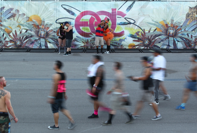 Fans take pictures as attendees arrive at the Electric Daisy Carnival at Las Vegas Motor Speedway on Friday, June 20, 2014. (Chase Stevens/Las Vegas Review-Journal)