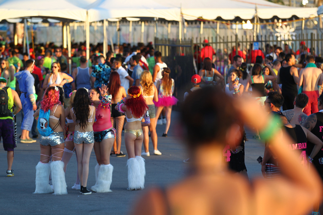 Attendees wait near an entrance as people arrive at the Electric Daisy Carnival at Las Vegas Motor Speedway on Friday, June 20, 2014. (Chase Stevens/Las Vegas Review-Journal)