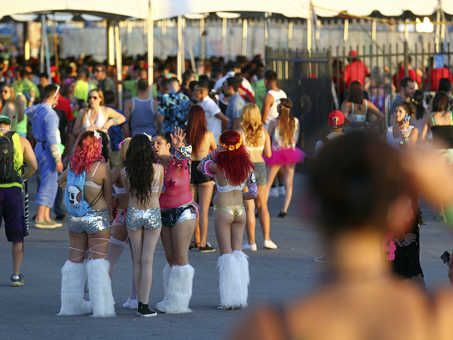 Attendees wait near an entrance as people arrive at the Electric Daisy Carnival at the Las Vegas Motor Speedway in Las Vegas on Friday, June 20, 2014. (Chase Stevens/Las Vegas Review-Journal)