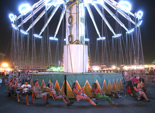Attendees wait for a carnival ride to begin at the Electric Daisy Carnival at the Las Vegas Motor Speedway in Las Vegas on Friday, June 20, 2014. (Chase Stevens/Las Vegas Review-Journal)