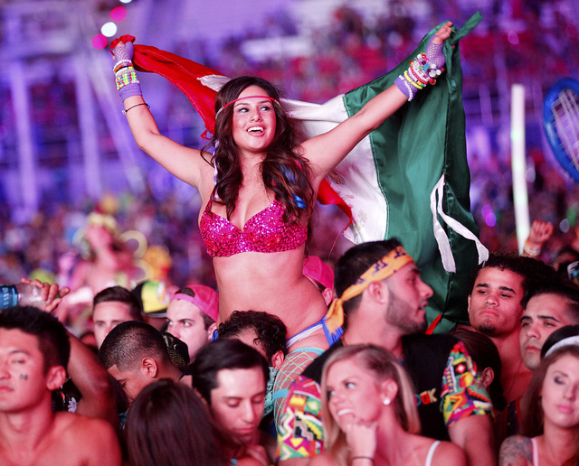 Attendees watch as Diplo performs at the Cosmic Meadow stage at the Electric Daisy Carnival at the Las Vegas Motor Speedway in Las Vegas during the early hours of Saturday, June 21, 2014. (Chase S ...