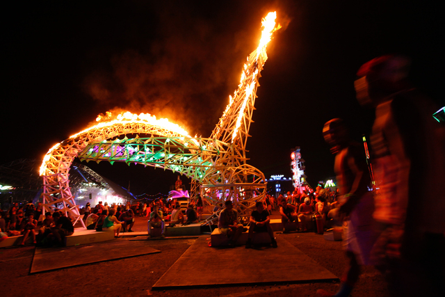 Attendees relax by an art installation at the Electric Daisy Carnival at the Las Vegas Motor Speedway in Las Vegas on Friday, June 20, 2014. (Chase Stevens/Las Vegas Review-Journal)