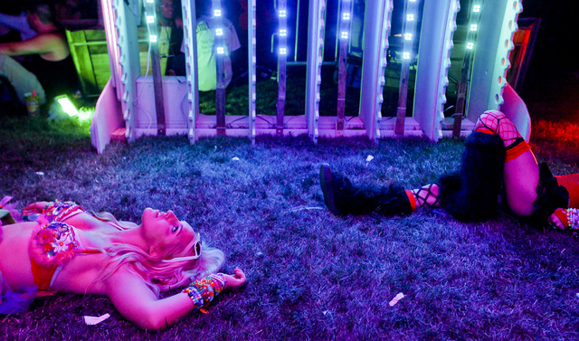 Tia Brandt of Los Angeles, Calif. watches the lights of an art installation at the Electric Daisy Carnival at the Las Vegas Motor Speedway in Las Vegas on Friday, June 20, 2014. (Chase Stevens/Las ...