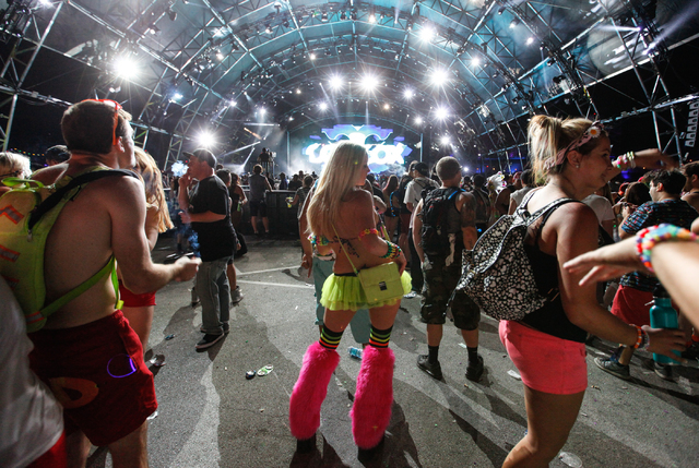 Attendees dance as Carl Cox performs at the Neon Garden stage at the Electric Daisy Carnival at the Las Vegas Motor Speedway in Las Vegas on Friday, June 20, 2014. (Chase Stevens/Las Vegas Review- ...