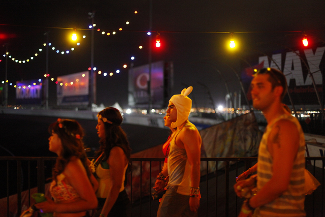 Attendees arrive at the Electric Daisy Carnival at the Las Vegas Motor Speedway in Las Vegas on Friday, June 20, 2014. (Chase Stevens/Las Vegas Review-Journal)