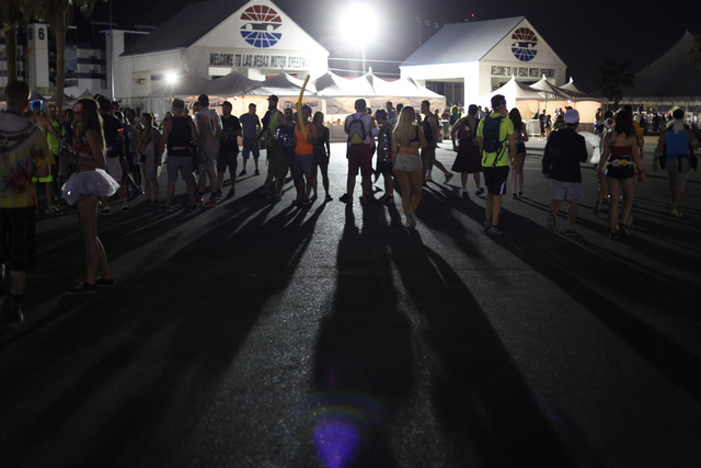 People stand around at the entrance to the Electric Daisy Carnival at the Las Vegas Motor Speedway in Las Vegas on Saturday, June 21, 2014. (Chase Stevens/Las Vegas Review-Journal)
