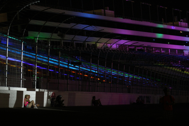 Attendees take a break as strobe lights flash from a nearby stage at the Electric Daisy Carnival at the Las Vegas Motor Speedway in Las Vegas on Friday, June 20, 2014. (Chase Stevens/Las Vegas Rev ...