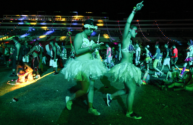 Attendees walk by the Cosmic Meadow stage as Destructo performs at the Electric Daisy Carnival at the Las Vegas Motor Speedway in Las Vegas on Saturday, June 21, 2014. (Chase Stevens/Las Vegas Rev ...