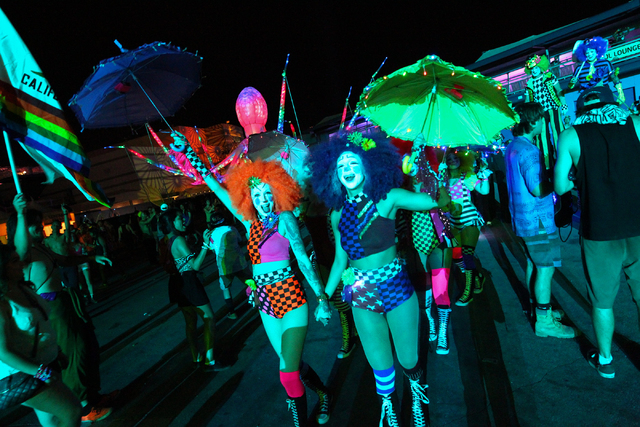 Costumed performers walk around at the Electric Daisy Carnival at the Las Vegas Motor Speedway in Las Vegas on Saturday, June 21, 2014. (Chase Stevens/Las Vegas Review-Journal)