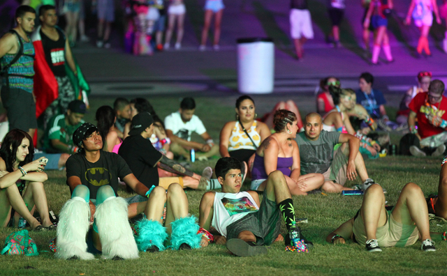 Attendees relax by the Cosmic Meadow stage at the Electric Daisy Carnival at the Las Vegas Motor Speedway in Las Vegas on Saturday, June 21, 2014. (Chase Stevens/Las Vegas Review-Journal)