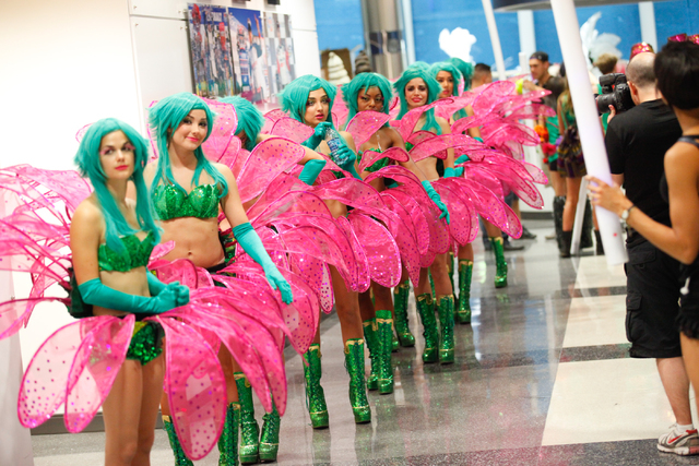 Costumed performers line up before heading out to mingle with the crowd at the Electric Daisy Carnival at the Las Vegas Motor Speedway in Las Vegas on Saturday, June 21, 2014. (Chase Stevens/Las V ...