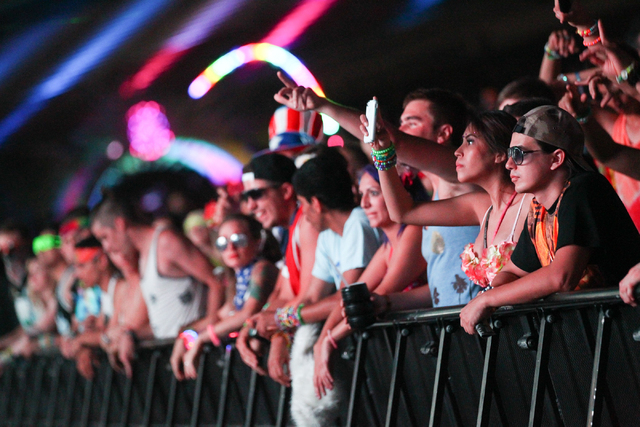 Attendees watch as Destructo performs while a video camera, left, films at the Cosmic Meadow stage at the Electric Daisy Carnival at the Las Vegas Motor Speedway in Las Vegas on Saturday, June 21, ...