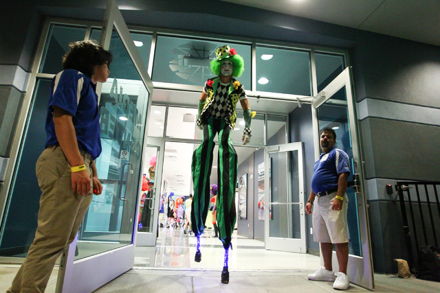 A costumed performer on stilts prepares to head out into the crowd at the Electric Daisy Carnival at the Las Vegas Motor Speedway in Las Vegas on Saturday, June 21, 2014. (Chase Stevens/Las Vegas  ...