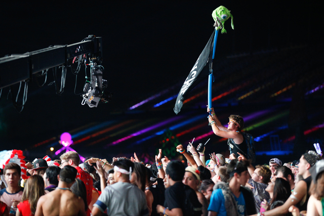 Fans watch as Destructo performs while a video camera, left, films at the Cosmic Meadow stage at the Electric Daisy Carnival at the Las Vegas Motor Speedway in Las Vegas on Saturday, June 21, 2014 ...