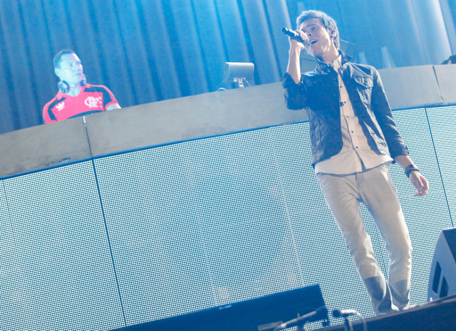 Matthew Koma, right, makes an appearance as Tiesto performs at the Kinetic Field stage at the Electric Daisy Carnival at the Las Vegas Motor Speedway in Las Vegas during the early hours of Sunday, ...