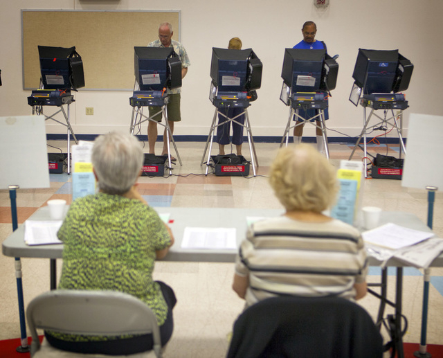 Voting as seen Tuesday, June 10, 2014 at D'Vorre & Hal Ober Elementary School at 3035 Desert Marigold Lane. Election officials are expecting a low turn out in today's primary election.(Jeff Scheid ...