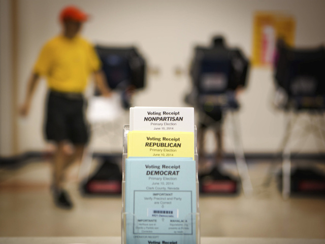 Voting as seen Tuesday, June 10, 2014 at D'Vorre & Hal Ober Elementary School at 3035 Desert Marigold Lane. Election officials are expecting a low turn out in today's primary election. (Jeff Schei ...