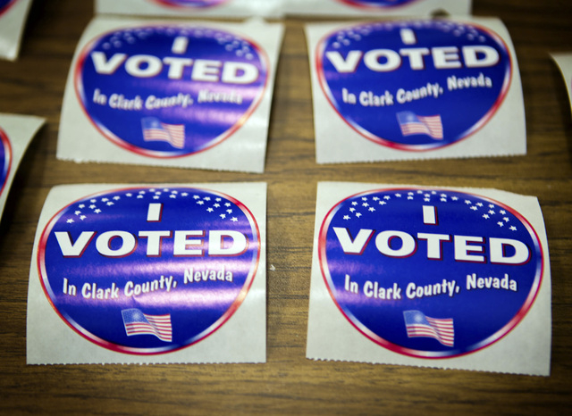 Voting stickers as seen Tuesday, June 10, 2014 at D'Vorre & Hal Ober Elementary School at 3035 Desert Marigold Lane. Election officials are expecting a low turn out in today's primary election.(Je ...