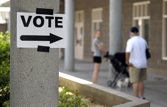 Voters chat outside the polling place at Del E. Webb Middle School in Anthem on Tuesday, June 10, 2014. By 8:30am, 29 voters had cast their votes at the Webb school polling place according to a pr ...