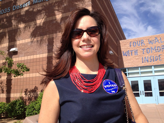 "Angelique Williams wears her ""I Voted"" sticker after submitting her ballot Tuesday morning, June 10, 2014, at the Ober Elementary School polling place in The Willows community in Las Vegas. (Keith ..."