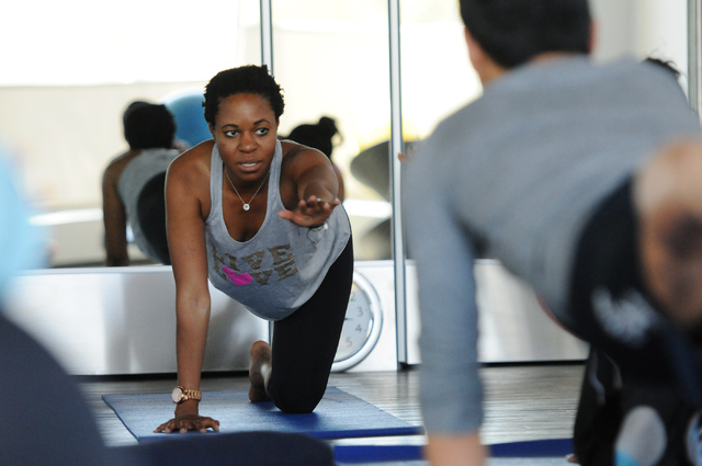 Yoga instructor Chidimma Ozor directs her students during her class at Turntable Health, June 9. (Erik Verduzco/View)