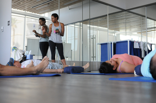 Yoga instructor Chidimma Ozor gets ready for her class at Turntable Health, June 9. (Erik Verduzco/View)
