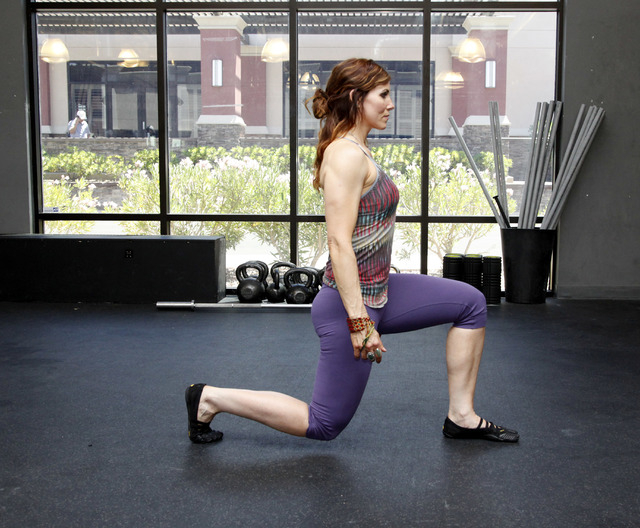 Trainer Laura Salcedo demonstrates the finishing position for a walking lunge at CrossFit Mountain's Edge in Las Vegas on Tuesday, May 27, 2014. (Justin Yurkanin/Las Vegas Review-Journal)