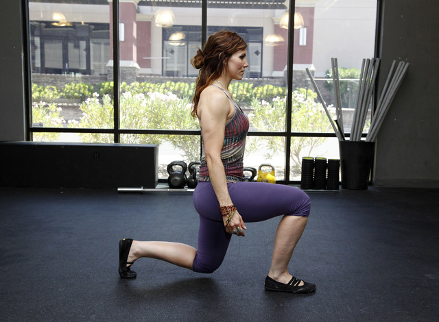 Trainer Laura Salcedo demonstrates the middle position for a walking lunge at CrossFit Mountain's Edge in Las Vegas on Tuesday, May 27, 2014. (Justin Yurkanin/Las Vegas Review-Journal)