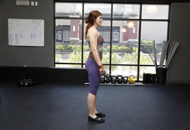 Trainer Laura Salcedo demonstrates the starting position for a walking lunge at CrossFit Mountain's Edge in Las Vegas on Tuesday, May 27, 2014. (Justin Yurkanin/Las Vegas Review-Journal)