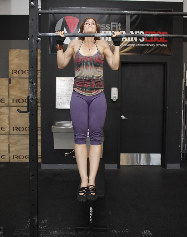 Trainer Laura Salcedo demonstrates the starting position negative pull up bar exercise CrossFit Mountain's Edge in Las Vegas on Tuesday, May 27, 2014. (Justin Yurkanin/Las Vegas Review-Journal)
