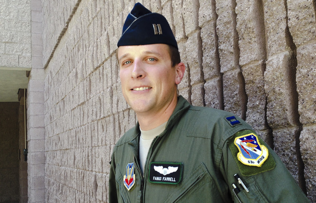"F-16 pilot Capt. Greg ""Fangs"" Farrell stands Thursday, June 12, 2014, outside the public affairs office at Nellis Air Force Base after reflecting on his role in rescuing a fellow pilot w ..."
