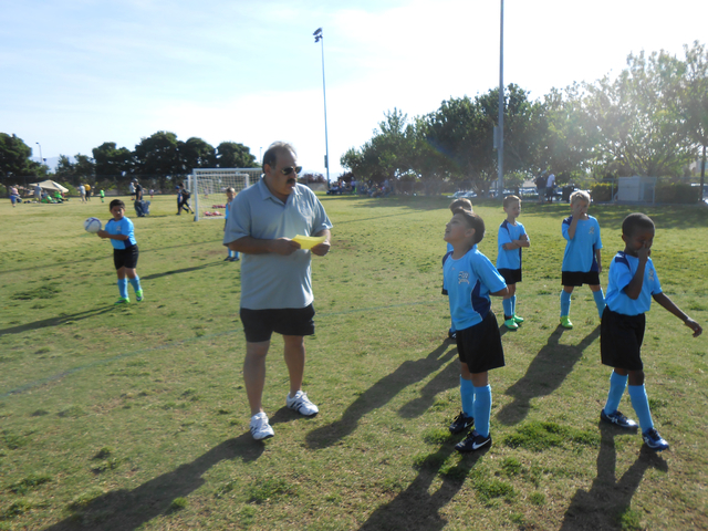 """Carlos Puche instructs children on the soccer team he coaches May 17 at The Crossing Park, 1111 Crestdale Lane. """"He's the best person I've ever met, the whole package,"""" said his wife, Nancy. ..."""