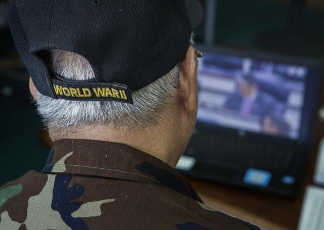Filipino-American World War II veteran Anastacio Sumajit watches the Committee on Armed Services hearing live stream on a computer, Tuesday, June 24, 2014. Congressman Joe Heck conducted the heari ...