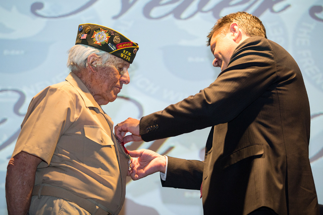 Gaetano R. Benza, 89, is pinned with the Legion of Honor by Eric Auger, the honorary consul of France in Southern Nevada, for his service in World War II at the Silverton on Friday, May 30, 2014.  ...