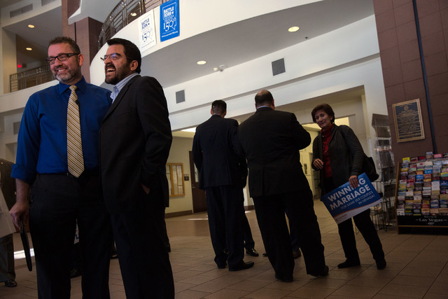 Theo Small, left, and his partner Antioco Carillo (cq), second from left, are interviewed following the launch of Freedom Nevada on Thursday, Feb. 13, 2014 at the Grant Sawyer Building. The campai ...