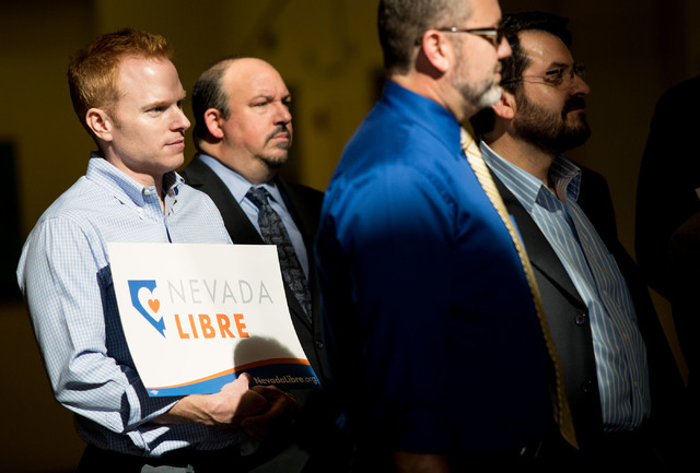 Steven Amend, far left, a volunteer with Human Rights Campaign, Jeff Garofalo, a lawyer and self-described conservative Republican, second from left, and partners Theo Small and Antioco Carillo (c ...