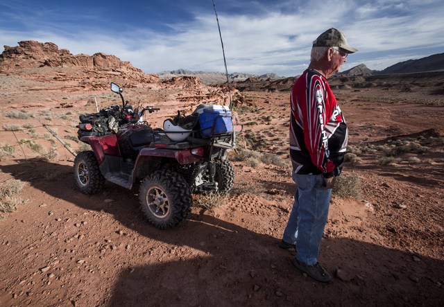 Bob Hitchcock stands near his ATV at Little Finland, also known as Hobgoblin's Playground and Devil's Fire, on Thursday, May 22, 2014. The Gold Butte Region, administered by the BLM and the U.S. N ...