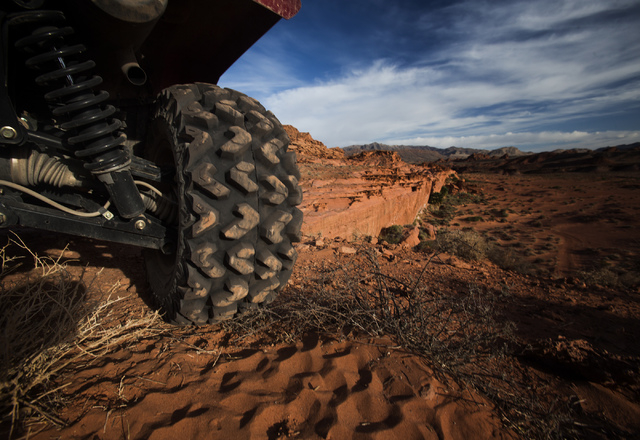An ATV is parked at Little Finland, also known as Hobgoblin's Playground and Devil's Fire, on Thursday, May 22, 2014. The Gold Butte Region, administered by the BLM and the U.S. National Park Serv ...