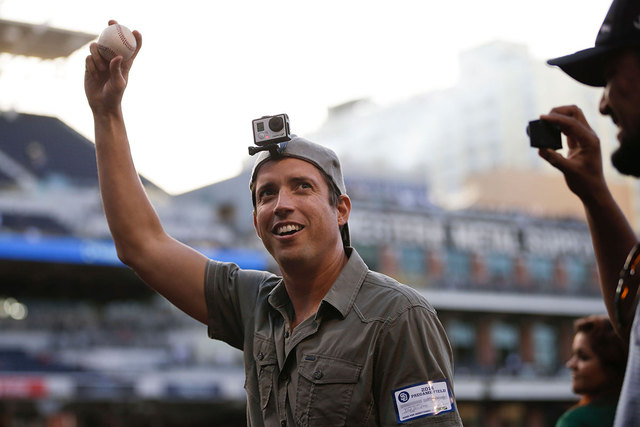 GoPro founder and CEO Nick Woodman wears a GoPro camera on his head before throwing out a ceremonial first pitch before a baseball game between the San Diego Padres and the Washington Nationals in ...