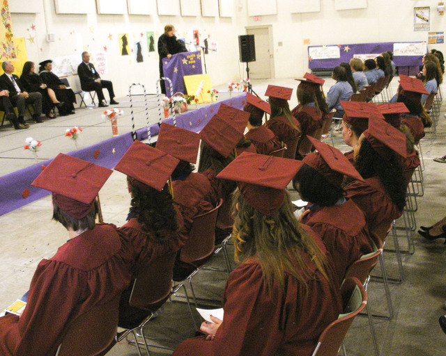 Clark County School Board member Patrice Tew speaks to inmates of the Florence McClure Women's Correctional Center at their high school graduation on Tuesday, June 3, 2014. Other inmates in their  ...