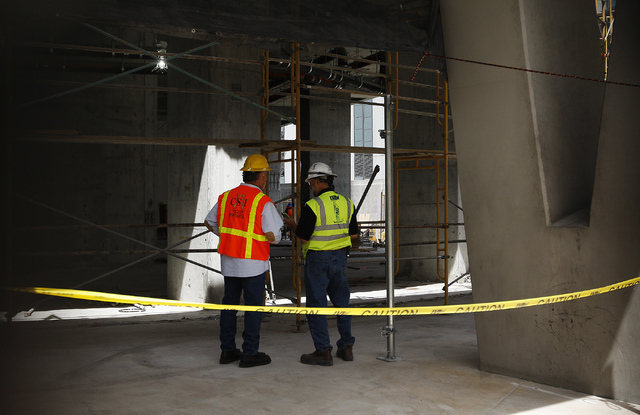 Workers are seen on the ground floor during the demolition of the Harmon Hotel at City Center in Las Vegas on Friday, June 20, 2014. (Jason Bean/Las Vegas Review-Journal)