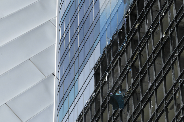 A window pane falls to the ground from the south side of the Harmon Hotel at City Center during the demolition of the building in Las Vegas on Friday, June 20, 2014. (Jason Bean/Las Vegas Review-J ...