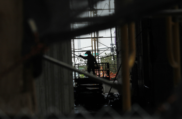 A worker is seen during the demolition of the Harmon Hotel at City Center in Las Vegas on Friday, June 20, 2014. (Jason Bean/Las Vegas Review-Journal)