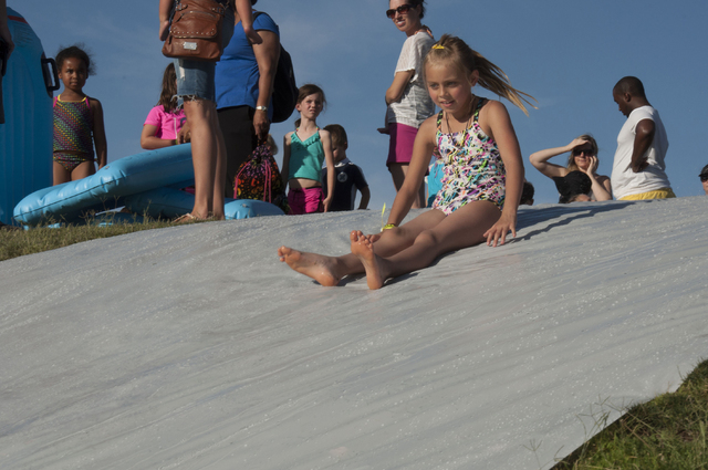 Children participate in the 2013 Slide into Summer event sponsored by the city of Henderson. This year's event is slated to feature games and activities including giant lawn-top water slides from  ...