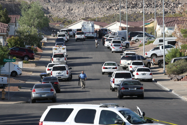 A Henderson police officer was hospitalized Wednesday morning, June 11, 2014, after he was shot or struck by shrapnel during a fatal officer-involved shooting. The suspect in the shooting was kill ...