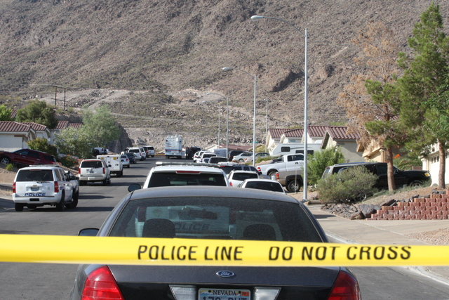 A Henderson police officer was hospitalized Wednesday morning after he was shot or struck by shrapnel during a fatal officer-involved shooting. June 11, 2014 (Michael Quine/Las Vegas Review-Journal)
