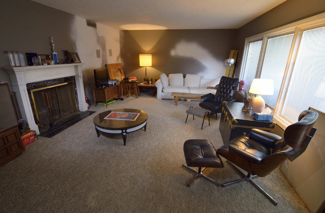 A living room which is undergoing some renovations is shown at the home of Dayvid Figler near the intersection of 6th Street and Charleston Boulevard in Las Vegas on Friday, June 13, 2014. (Bill H ...