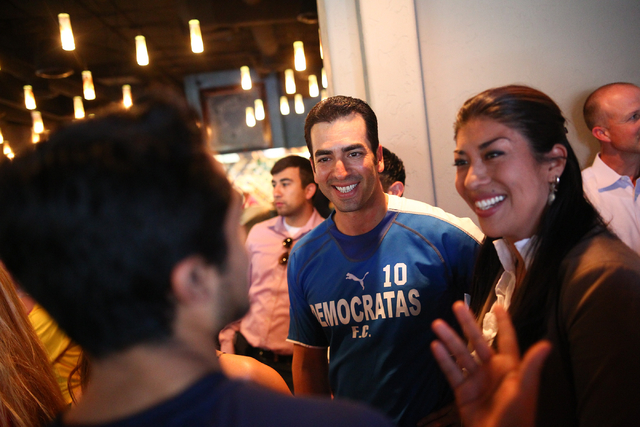 "State Sen. Ruben Kihuen, D-Las Vegas, center, and Assemblywoman Lucy Flores, D-Las Vegas, talk with Las Vegas Park Commissioner David Lopez, left, during Kihuen's ""Soccer with the Senator&quo ..."