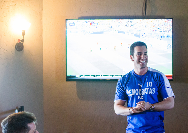 "State Sen. Ruben Kihuen, D-Las Vegas, speaks during his ""Soccer with the Senator"" event for supporters featuring a watch party for the Mexico vs. Brazil World Cup game at Tacos & Beer, 3 ..."